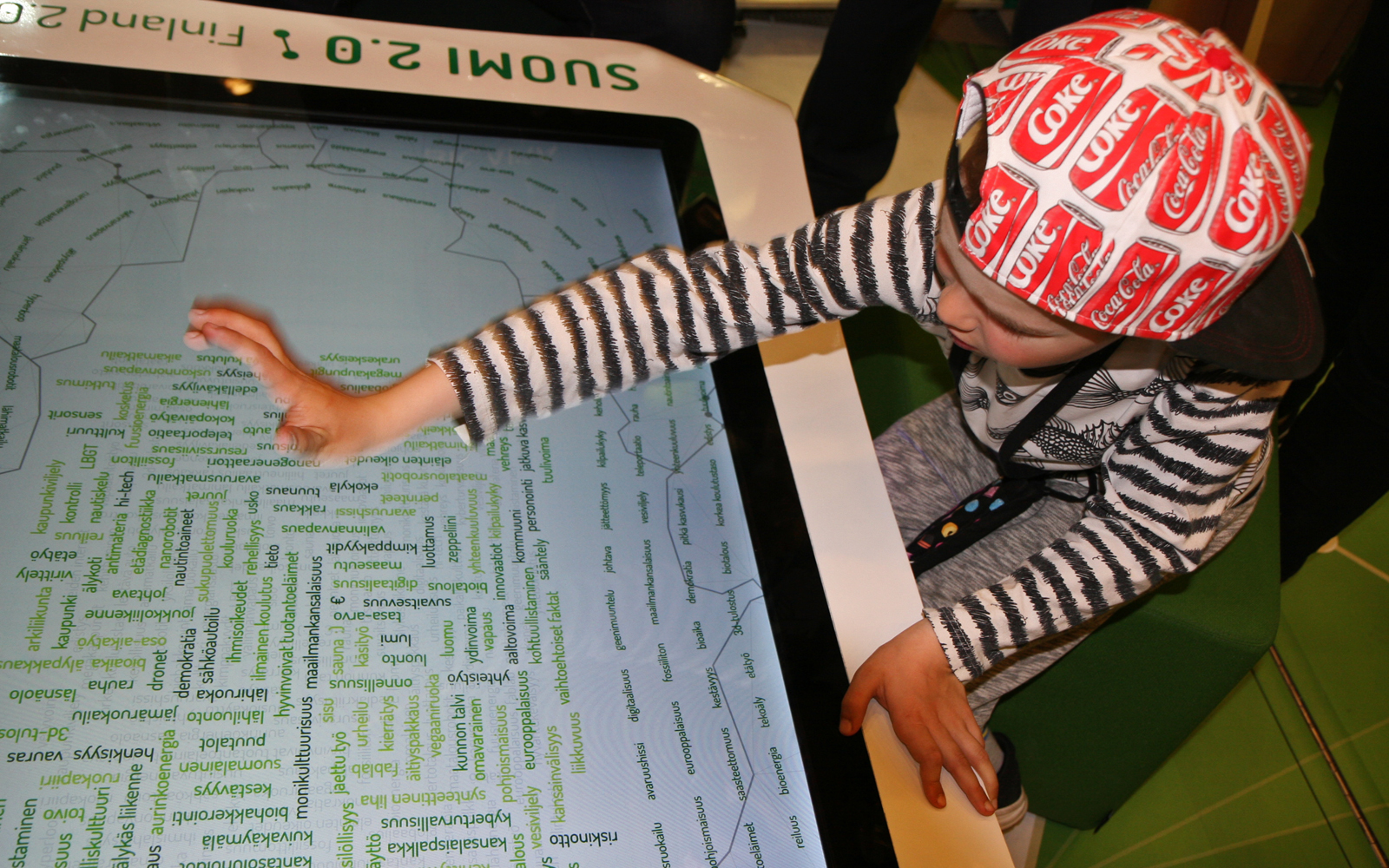Visitors can choose and drag what they think are the most important words to the centre of the word cloud, thus helping to create a future vision for centenarian Finland. Photo: Anna Kauppi