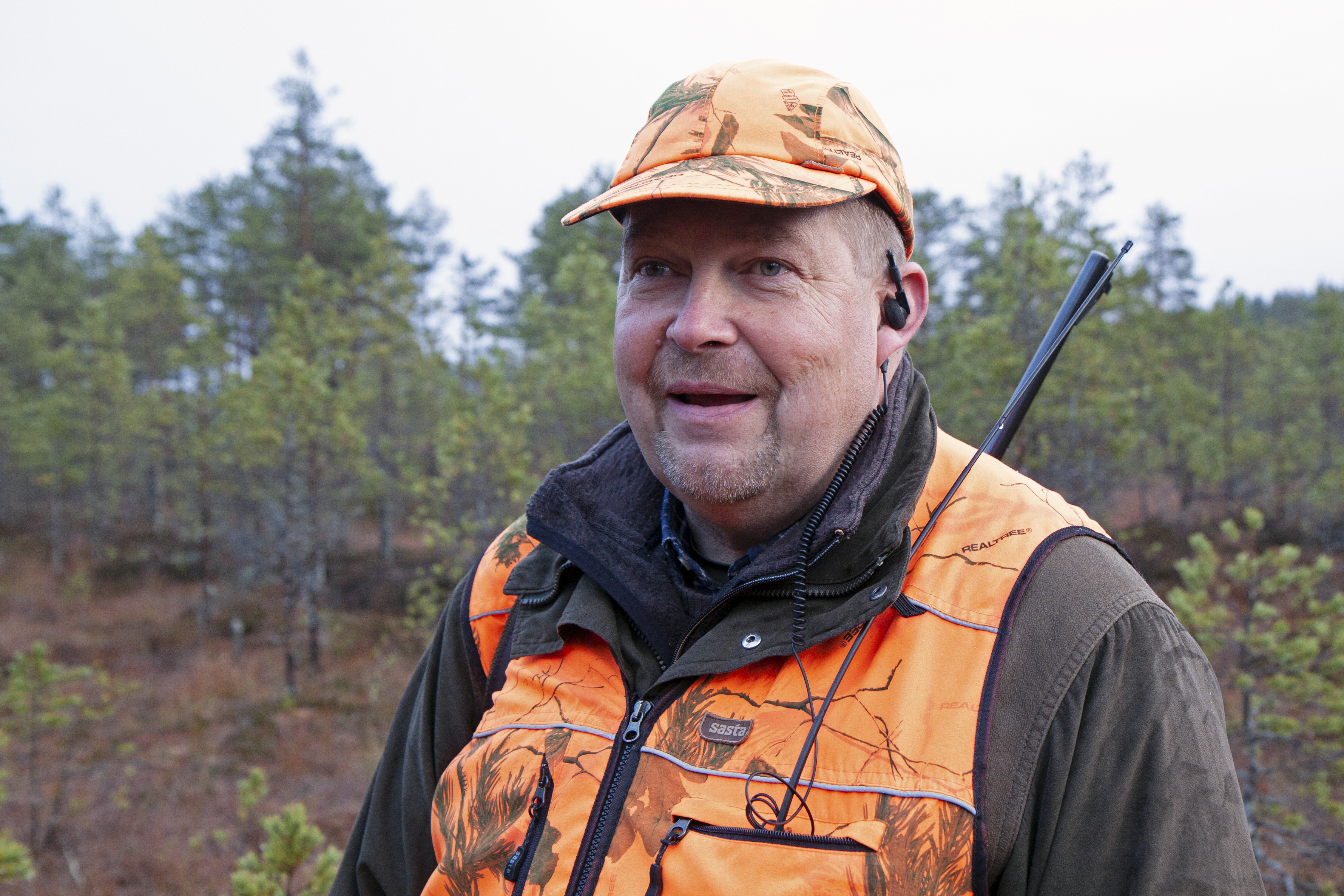 "Juha-Matti Valonen looks at forests as an environmental expert and a hunter. ""There is an exceptional volume of information on forests in Finland, but to make use of it, you still need men in rubber boots, like me."" Photo: Anna Kauppi"
