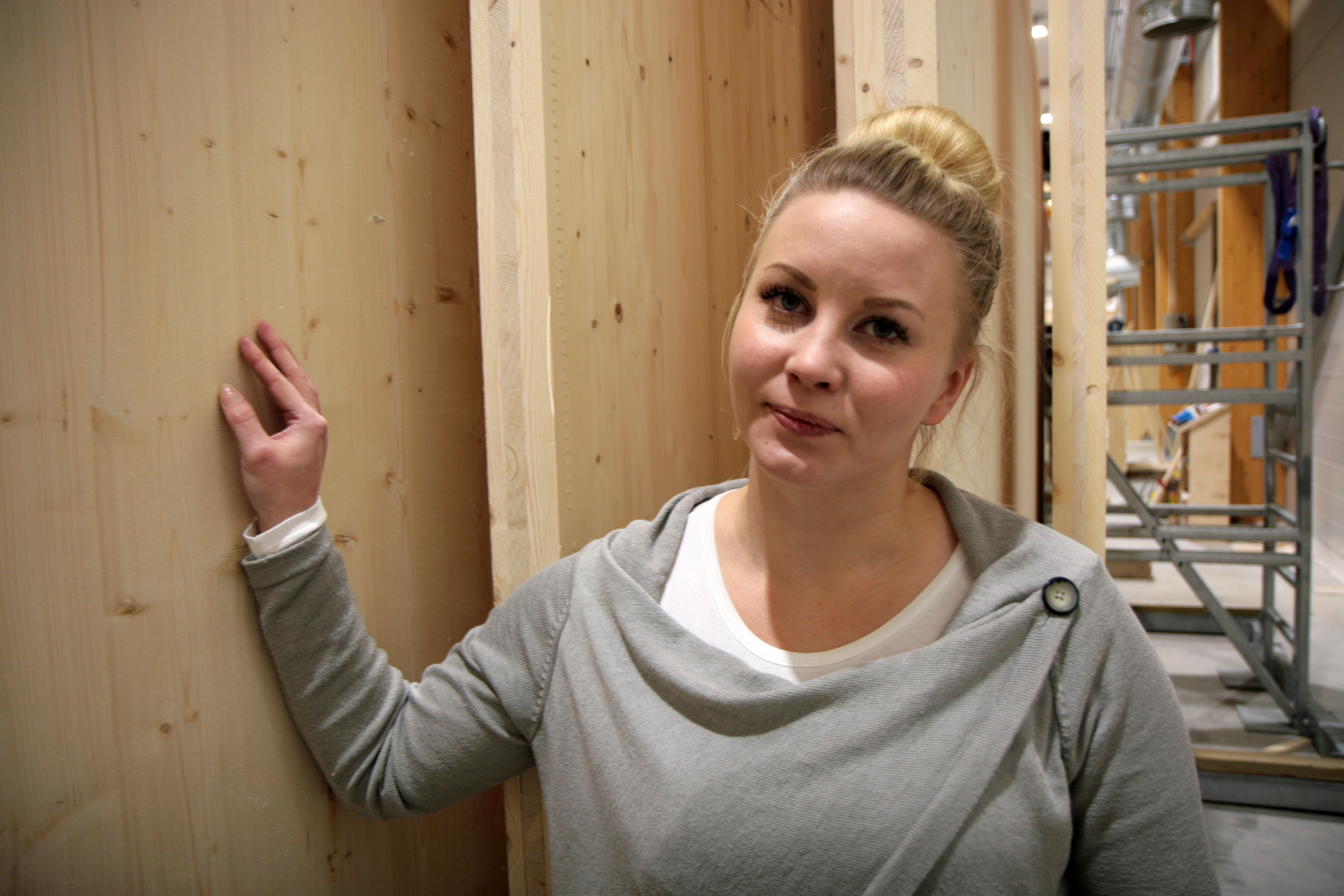 """You've got to be proud of having such forerunners of building with wood out here in the forests of Kainuu,"" says Annina Komulainen, who works as a construction engineer at the Elementti Sampo company. Photo: Anna Kauppi"