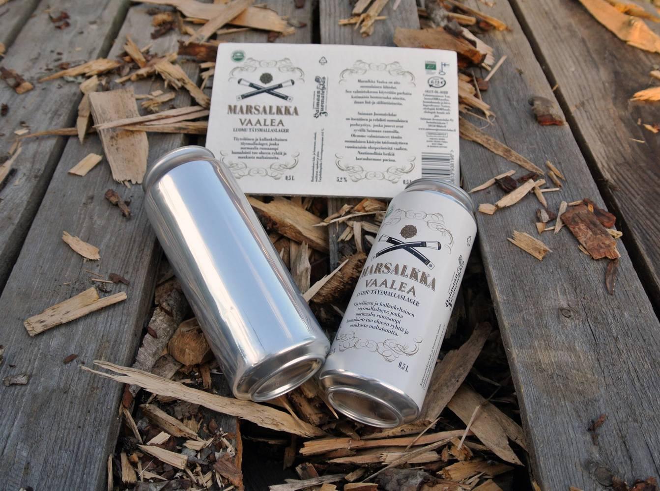 Etiketöity juomatölkki. Kuva: Auraprint